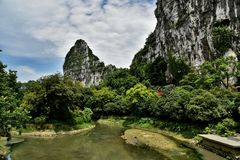 Karst moutain in guiling,china. Karst moutain with blue sky ,white clouds and lake in guiling , guangxi province,china royalty free stock photography