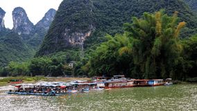Karst peaks in Xingping Town and pleasure boats on the Li River stock image