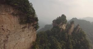 Karst Pillars at Wulingyuan National Park in Zhangjiajie. Aerial view of karst pillars at Wulingyuan National Park in China. Located in Historic Interest Area stock video footage