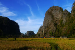Karst rock wall in Ramang-ramang. A village is surrounded by karst rock wall in ramang-ramang tourist destination in Maros, South Sulawesi, Indonesia Royalty Free Stock Photography