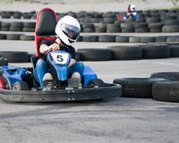 Kart crossing the finish line action, speed, helmet, track, driver, competition, motor, motion, adrenalin. Kart crossing the finish line action, speed, helmet Stock Images