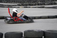 Kart crossing the finish line action, speed, helmet, track, driver, competition, motor, motion, adrenalin. Kart crossing the finish line action, speed, helmet Royalty Free Stock Photography