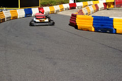 Kart Race. A racer in a kart driving on a limited kart track through the curve royalty free stock photography
