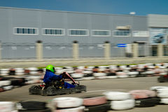 Kart racer speed. A man is driving Go-kart with speed in the park on karting track - front view Stock Photos