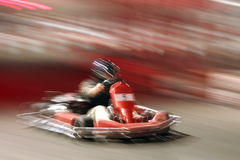 Kart racing II. Full speed on the track by kart royalty free stock photos