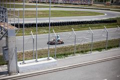 Kart track and kart driver on track. Summer, active family fun or sports stock photo