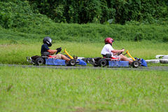 Kart in a turn. Two kart in a turn, following each other Stock Photo