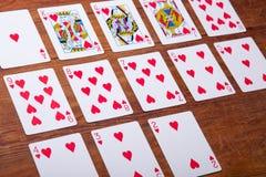 Karta do gry na drewnianym tle Obrazy Stock