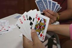 Karta do gry w ręce Fotografia Royalty Free