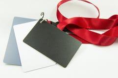 Karta na czerwonej taśmie Zdjęcie Stock
