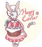 Karta z królikiem trzyma kosz Wielkanocni jajka Zdjęcia Stock