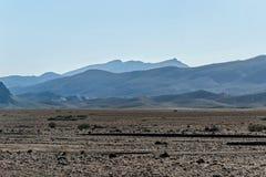 kartbokberg med öknen i Marocko Arkivbild