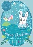 Karte der frohen Weihnachten mit Kaninchen und Fliegen steigt im Ballon auf Lizenzfreie Stockfotografie