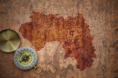 Karte der Guine auf einem alten Weinlesesprungspapier lizenzfreies stockbild