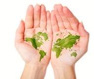 Karte der Welt gemalt auf Händen Lizenzfreie Stockfotos