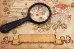 Karte und Vergrößerungsglas lizenzfreie stockbilder