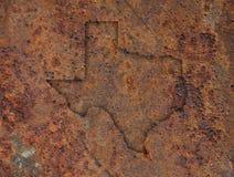 Karte von Texas auf rostigem Metall stockbilder