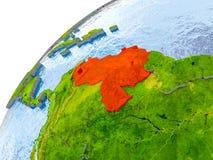 Karte von Venezuela im Rot auf Kugel Stockbild