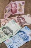Karten von 20, 50, 200 und 500 mexikanischen Pesos scheinen, traurig zu sein Stockfotos