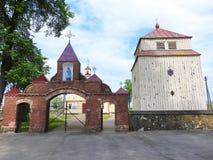 Kartena church gate, Lithuania. Kartena town church gate and belfry, Lithuania Stock Photo