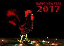 Kartenhintergrund des guten Rutsch ins Neue Jahr 2017 mit handgemachtem Handwerkshahn Stockfoto