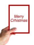 Kartenmitteilung der frohen Weihnachten Stockfotos