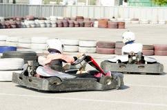 Karting变蓝司机的行动 图库摄影