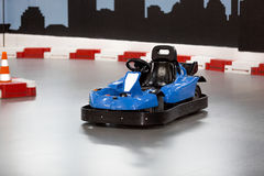 Karting area with barriers and small blue kart Stock Photo