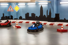Karting area for children with small karts. Indoor karting area for children with small karts Royalty Free Stock Photos