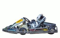 Karting auf einem weißen Hintergrund, Schutzhelme auf dem Sitz Lizenzfreie Stockfotos