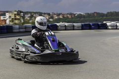 Karting Championship. Driver in karts wearing helmet, racing suit participate in kart race. Karting show. Children Royalty Free Stock Photography