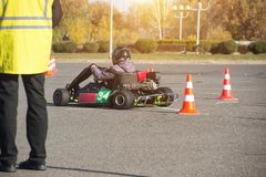 Karting competitions, the judge evaluates and puts points to the participants in the karting competition, carting royalty free stock photo