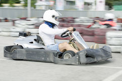 Karting driver motion blued Royalty Free Stock Photography
