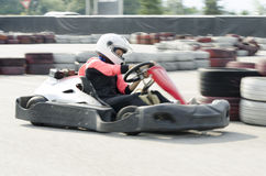 Karting driver motion blued Royalty Free Stock Photo