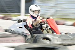 Karting driver motion blued Stock Photo