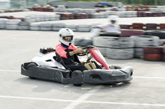Karting driver motion blued Royalty Free Stock Photos