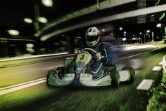 Karting - kierowca w hełmie na karta obwodzie obrazy royalty free