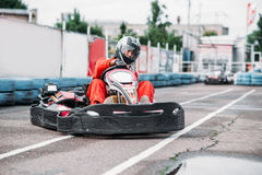 Karting racer in action, go kart competition Stock Photos