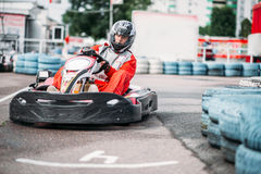 Karting racer in action, go kart competition. On outdoor track. Carting championship royalty free stock photo