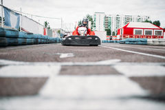 Karting racer on finish line, go kart competition Royalty Free Stock Photos