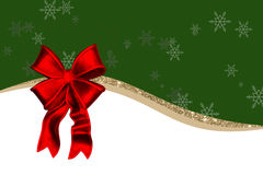 Kartka bożonarodzeniowa z czerwonymi dekoracjami, łęk, złoty faborek, zielony tło Zdjęcia Stock