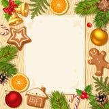 Kartka bożonarodzeniowa z jedlinowymi gałąź, piłkami i ciastkami na drewnianym tle, Zdjęcia Stock