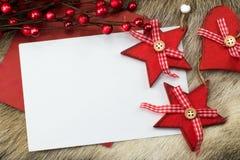 Kartka bożonarodzeniowa z czerwieni sercem i gwiazdami Zdjęcia Stock