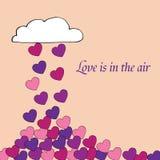 Kartka z pozdrowieniami miłość jest w powietrzu, romantycznym, z mnóstwo sercami ten spadać od chmury Zdjęcia Stock