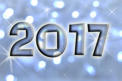 2017 kartka z pozdrowieniami na błękitnych błyszczących wakacji światłach Fotografia Stock