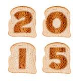 2015 kartka z pozdrowieniami na wznoszących toast plasterkach chleb Obrazy Royalty Free