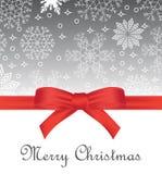Kartka z pozdrowieniami z czerwonym łękiem na płatka śniegu tle i kopii przestrzeni Obrazy Royalty Free