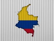 Kartlägga och flaggan av Colombia på korrugerat järn Royaltyfria Bilder