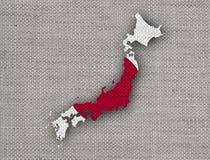 Kartlägga och flaggan av Japan på gammal linne Arkivfoto