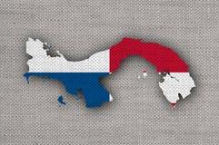 Kartlägga och flaggan av Panama på gammal linne Royaltyfri Foto